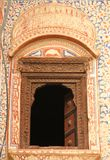 A decorated window in Mandawa. A decorated window forms part of a facade of a building in Mandawa, India stock photos