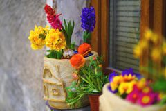 Decorated window sill with spring flowers in pots royalty free stock images