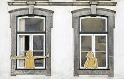 Decorated windows. Detail of windows with two decorative silhouettes Stock Image