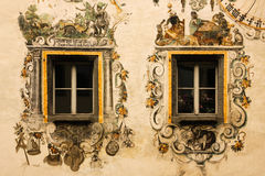 Decorated windows. Berchtesgaden.Germany. Façade. A bavarian house with traditional decorated windows in the Alps. Berchtesgaden. Germany Stock Images