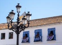 Decorated windows face Plaza de los Naranjos in Marbella Stock Images