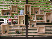 Decorated wooden boxes at the wall Stock Photos