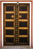 Decorated wooden door Royalty Free Stock Images