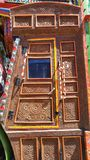 Decorated wooden door of a truck. Decorated pakistani truck decoration front side backside art artist paint painter flower heart culture wheels auto bedford stock image
