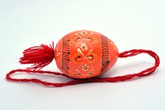 Wooden Easter egg with the red string. royalty free stock photo