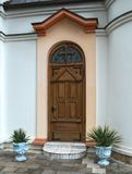 Decorated wooden front door of the church in Serbia Stock Images