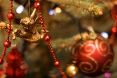 Decorated xmas tree (shallow dof, angel in focus) Royalty Free Stock Photo