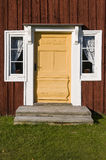 Decorated yellow entrance door Stock Images