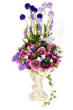 Decoratie kunstmatige plastic bloem met uitstekende ontwerpvaas Royalty-vrije Stock Afbeelding