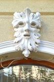 Decoratief gesneden gezicht bij de bouw van voorgevel Royalty-vrije Stock Afbeeldingen