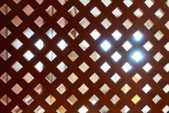 Decoratief houten rooster Houten achtergrond met lichtbron bij de rug royalty-vrije stock afbeeldingen