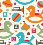 Decoratief naadloos patroon met speelgoedachtergrond met draaimolen, bromtol, gee-gee, hobbelpaard, bal, trompet Royalty-vrije Stock Foto's