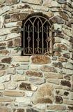 Decoratief venster in de muur Stock Foto's