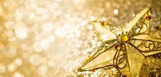 Decoratieve gouden ster op abstracte achtergrond Royalty-vrije Stock Afbeelding