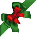 Decoratieve Nieuwjaar groene en rode boog met diagonaal lint op de hoek Vectorboog voor paginadecor Royalty-vrije Stock Foto's