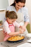 Decorating apple pie mother and daughter Royalty Free Stock Photography