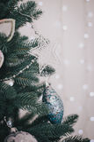 Decorating beautiful Christmas-tree Royalty Free Stock Photography