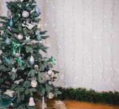Decorating beautiful Christmas-tree Stock Photography