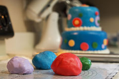Decorating a Birthday cake with Colored Fondant.  Royalty Free Stock Photo