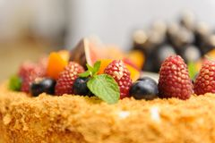 Decorating cake with berries, raspberries and blueberries close-up. The idea of the menu Royalty Free Stock Image