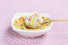 Decorating cake pops. Delicious chocolate snack. On pink background Stock Images
