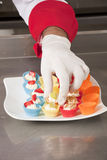 Decorating canapes Stock Photo