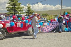Decorating a car in red, white & blue in Lima Montana Stock Image