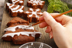Decorating christmas gingerbread chocolate cookies with white ic. Ing. Festive dessert Stock Images