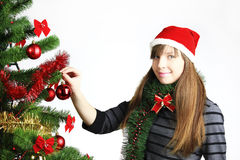 Decorating christmas tree Stock Photos