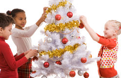 Decorating Christmas tree Royalty Free Stock Photography