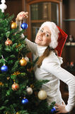Decorating christmas tree Royalty Free Stock Photo