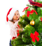 Decorating Christmas tree Royalty Free Stock Photos