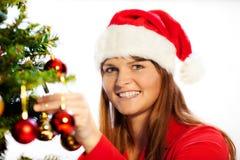 Decorating christmas tree Stock Photography