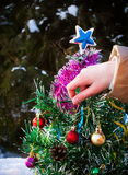 Decorating Christmas tree. With a ball Stock Image