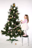 Decorating of christmas tree 2 Royalty Free Stock Photo