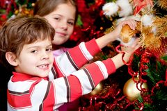Decorating a Christmas tree Royalty Free Stock Photo