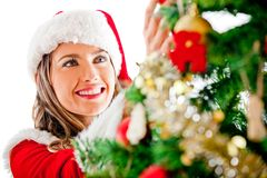 Decorating a Christmas tree Royalty Free Stock Images