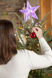 Decorating Christmas tree Stock Photography