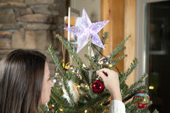 Decorating Christmas tree Royalty Free Stock Image