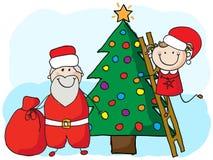 Decorating the christmas tree Royalty Free Stock Image