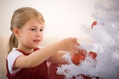 Decorating a christmas tree Royalty Free Stock Image