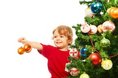 Decorating Christmas tree with balls Stock Photos