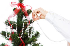 Decorating christmas tree. With balls, ribbons and stuff, isolated on white background Stock Photos