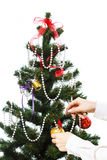 Decorating christmas tree. With balls, ribbons and stuff, isolated on white background Royalty Free Stock Image