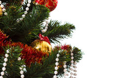 Decorating christmas tree. With balls, ribbons and stuff, isolated on white background Royalty Free Stock Images