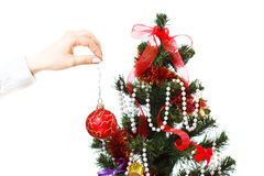 Decorating christmas tree. With balls, ribbons and stuff, isolated on white background Stock Photography