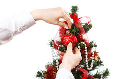 Decorating christmas tree. With balls, ribbons and stuff, isolated on white background Stock Image