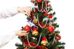 Decorating christmas tree. With balls, ribbons and stuff, isolated on white background Stock Images