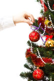 Decorating christmas tree. With balls, ribbons and stuff, isolated on white background Royalty Free Stock Photos