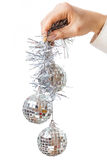 Decorating christmas tree. With balls, ribbons and stuff, isolated on white background Royalty Free Stock Photo